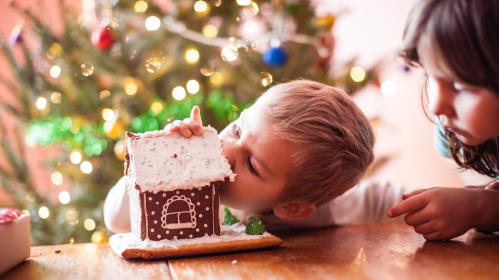 Child eating gingerbread house