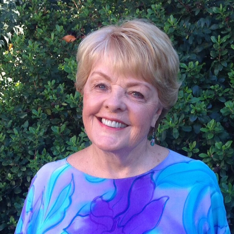 Portrait of Rev. Carolyn at CSLChico wearing blue and purple