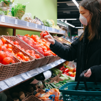 Woman wearing a mask at the grocery store during covid 19