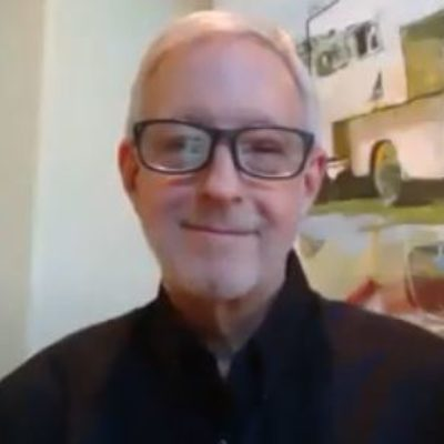 Screen shot of John Boyle in glasses over Zoom leading an online Guided Meditation based on Science of Mind Philosophy