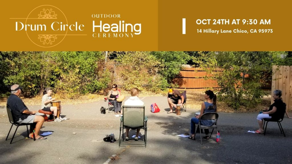 Photo of outdoor event. Picture of a group of people sitting in a circle for a community drum circle. Healing Ceremony for California based Spiritual Community in Chico Ca at Center for Spiritual Living Chico
