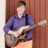 Photo of Amber Darland with guitar. Sunday Inspiration Lesson for Center for Spiritual Living Chico Ca