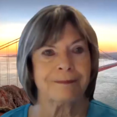 Screen shot of woman giving an online recording of a guided meditation