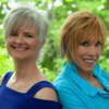 Karen Taylor Good & Stowe Daily online performance with Center for Spiritual Living Chico two women musicians smiling and standing shoulder to shoulder with short hair in blue