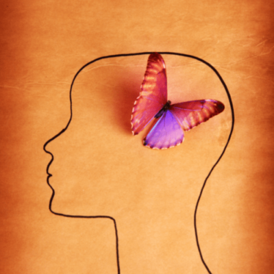 Image of a black outline of a person's head thinking with a purple and pink butterfly