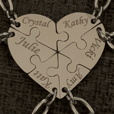 Metal heart key chain. with customs names engraved to create a puzzle heart shape