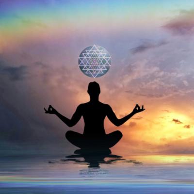 Figure meditation over water ripple sunset and rainbow image of serenity