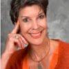 Rev Nadene Rogers portrait of female waering orange top
