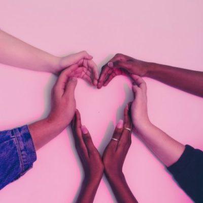Diversity hands creating a heart shape