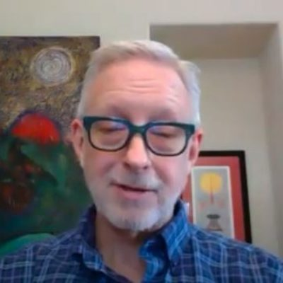 John Boylr wearing blue button up shirt with black glasses screen shot of Sunday Service Guided Meditation
