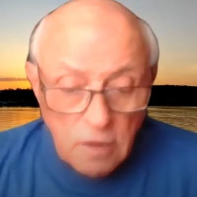 Screen capture of online YouTube and Zoom guided meditation on aligning with your higher self lead by Andy R.Sc.P. for New Thought community in Chico Ca image of older man wearing blue shirt talking