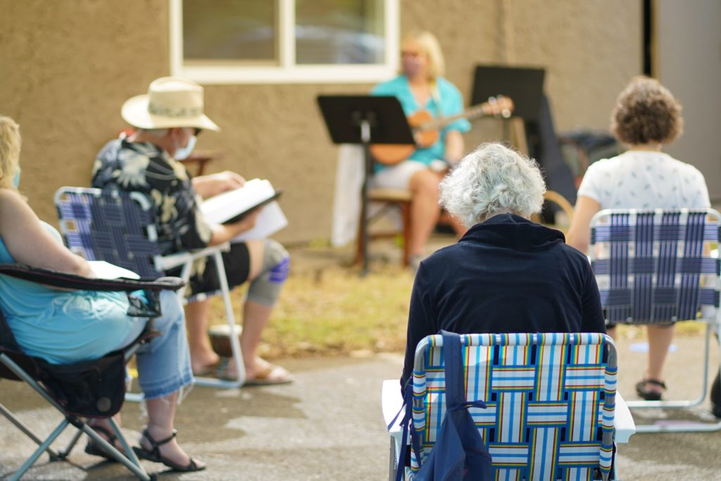 Center for Spiritual Living Chico Choir meeting outside for covid people social distancing